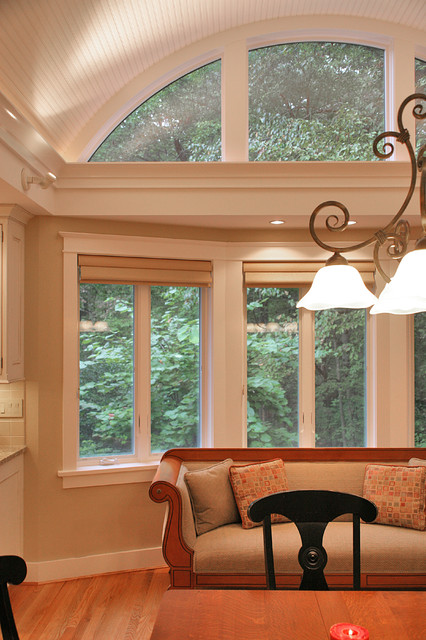 arched windows over bay window traditional dining room