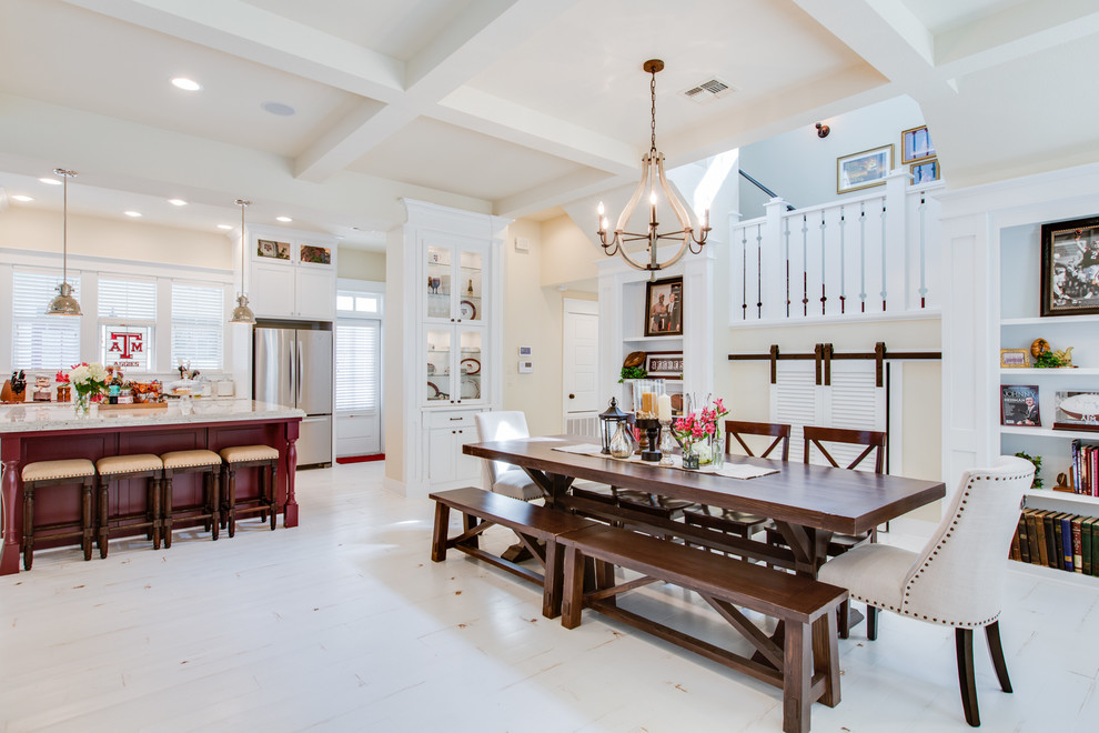 Cottage painted wood floor kitchen/dining room combo photo in Austin with beige walls