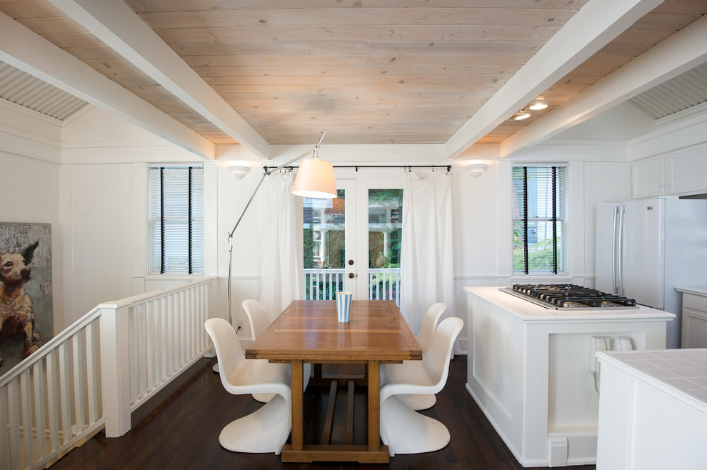 Example of an eclectic dark wood floor kitchen/dining room combo design in San Francisco with white walls