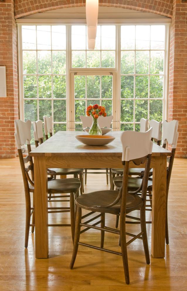 Dining room - rustic medium tone wood floor dining room idea in San Francisco