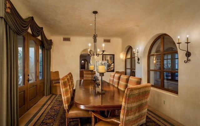 Example of a huge classic terra-cotta floor enclosed dining room design in Phoenix with beige walls