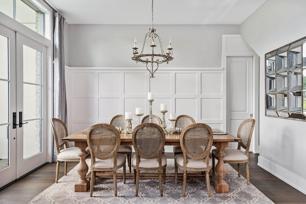 Enclosed dining room - large transitional dark wood floor and brown floor enclosed dining room idea in Orlando with gray walls