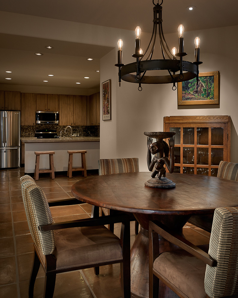 Kitchen/dining room combo - southwestern kitchen/dining room combo idea in Phoenix with white walls