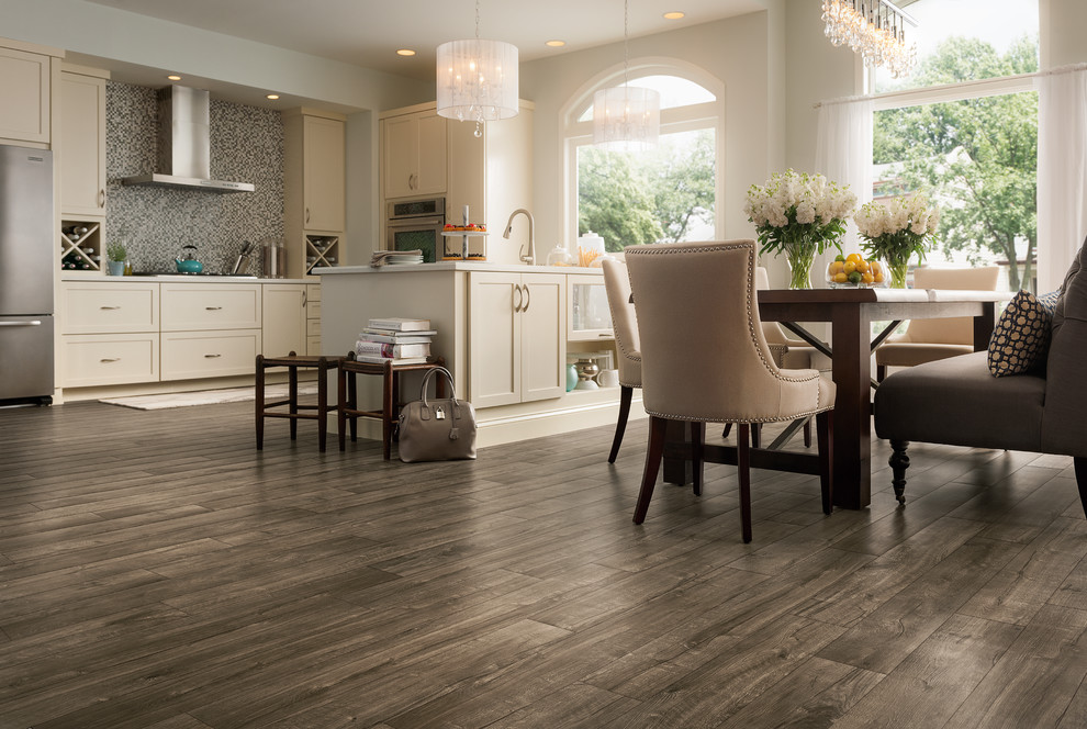 Example of a mid-sized transitional vinyl floor and brown floor kitchen/dining room combo design in Other with white walls