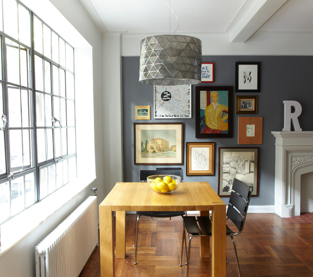 Inspiration For A Small Industrial Medium Tone Wood Floor Great Room  Remodel In New York With