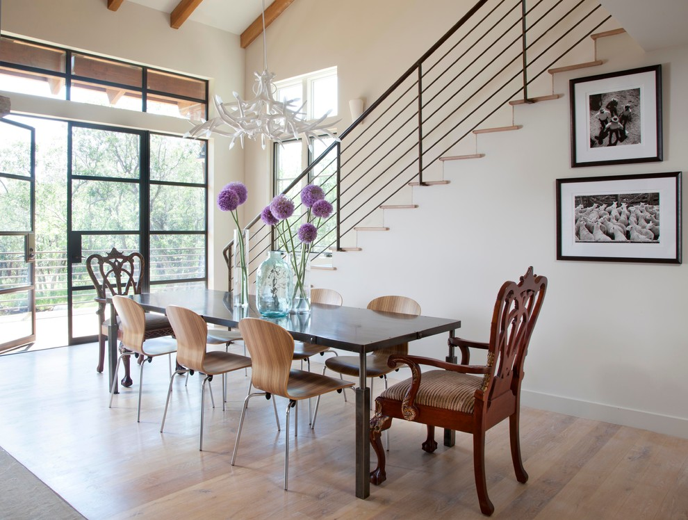 Inspiration for a rustic medium tone wood floor dining room remodel in Denver with white walls