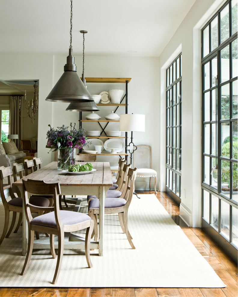 Cottage medium tone wood floor dining room photo in Atlanta with white walls