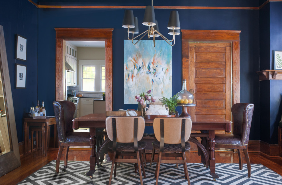 Inspiration for a mid-sized eclectic enclosed dining room remodel in Atlanta with blue walls