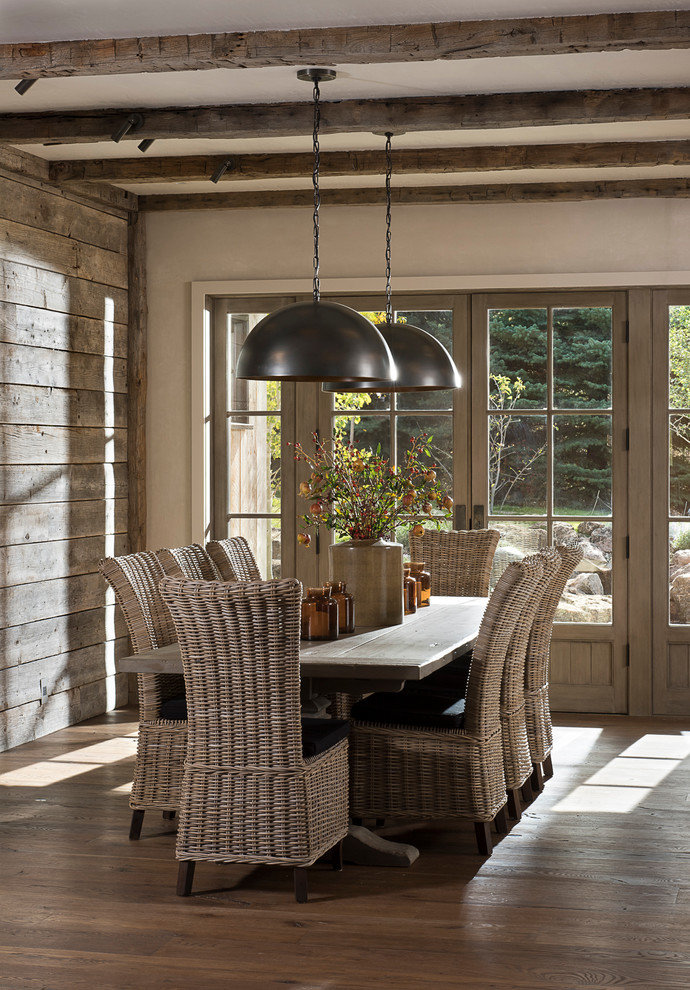 Dining room - rustic dark wood floor dining room idea in Other with gray walls