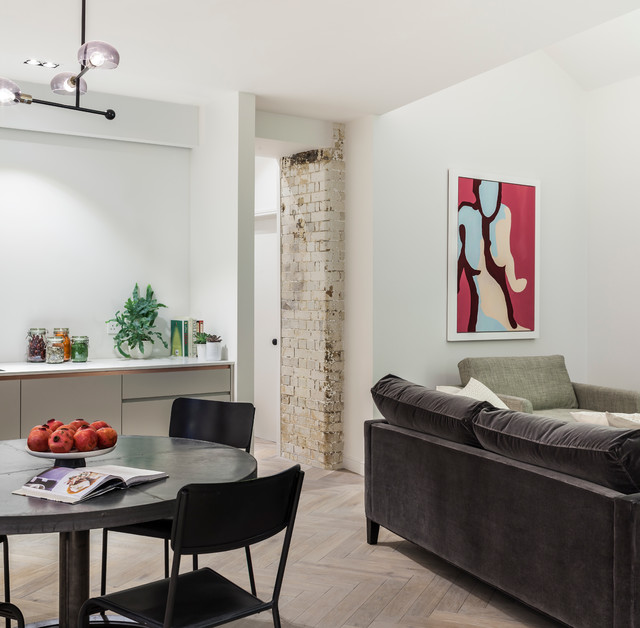 Great room - contemporary light wood floor great room idea in London with white walls