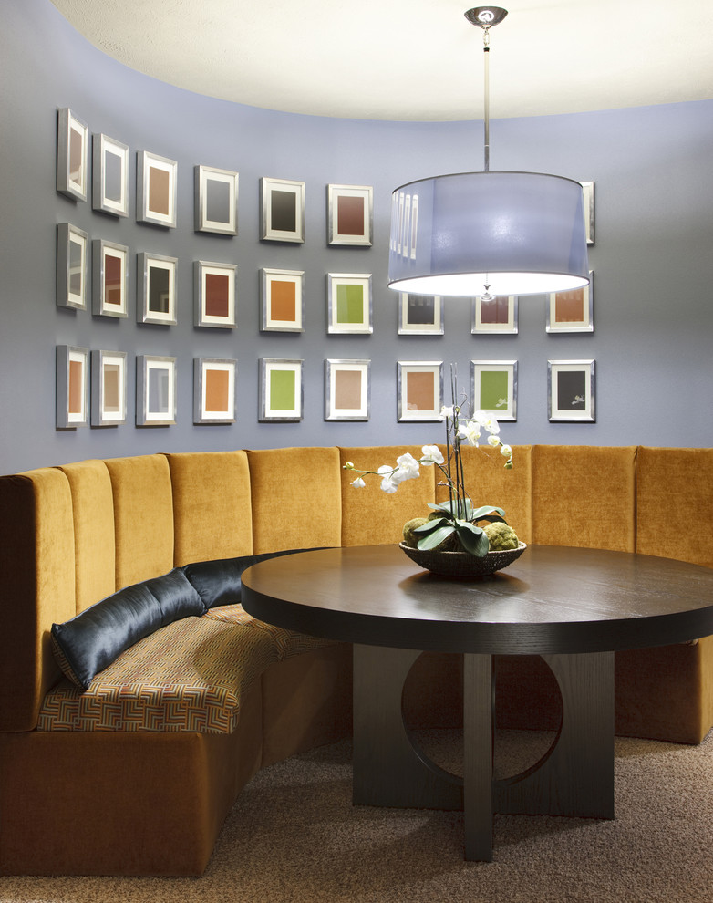 Inspiration for a contemporary dining room remodel in Chicago with purple walls