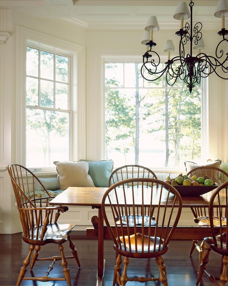 Dining room - coastal dark wood floor dining room idea in Boston with white walls