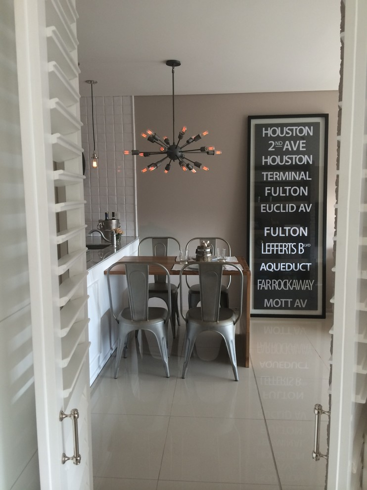 Kitchen/dining room combo - small industrial ceramic tile kitchen/dining room combo idea in Other with brown walls