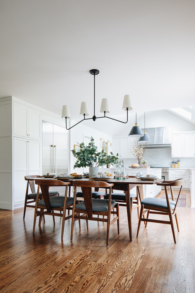 Kitchen/dining room combo - large transitional medium tone wood floor and brown floor kitchen/dining room combo idea in Chicago with white walls