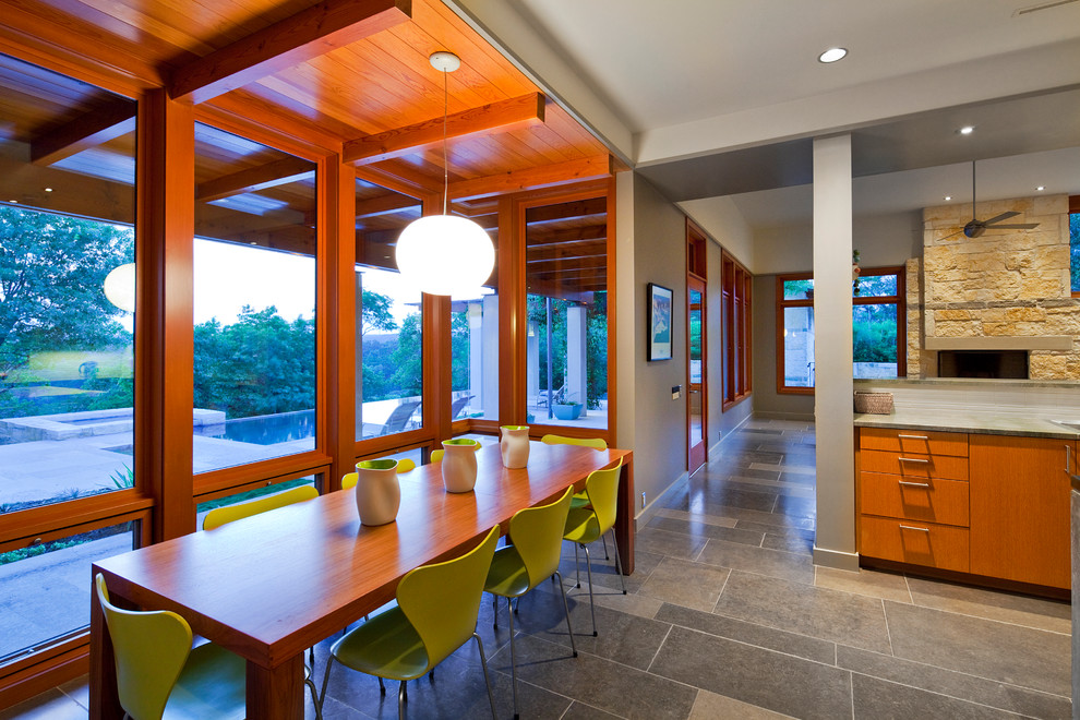 Example of a trendy slate floor dining room design in Austin