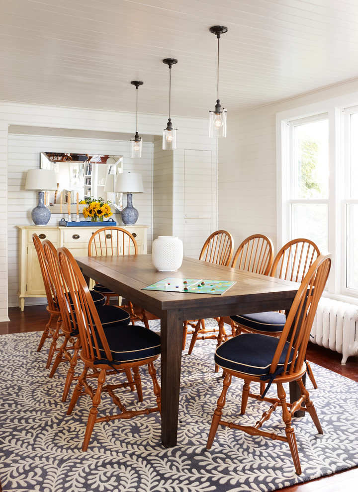 Example of a classic dark wood floor dining room design in Chicago with white walls