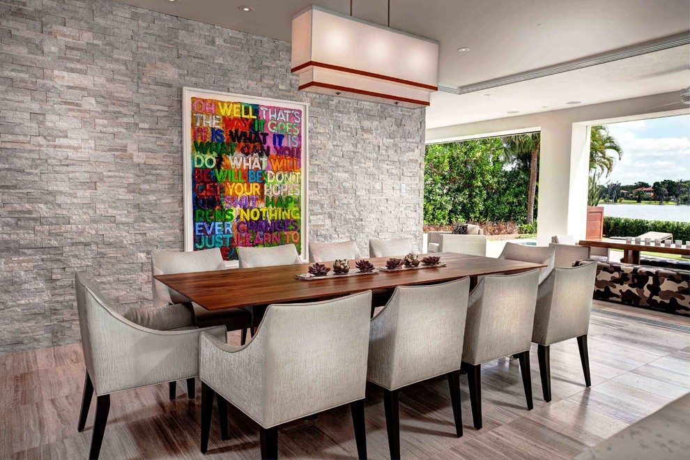Example of a trendy dining room design in Orlando with white walls