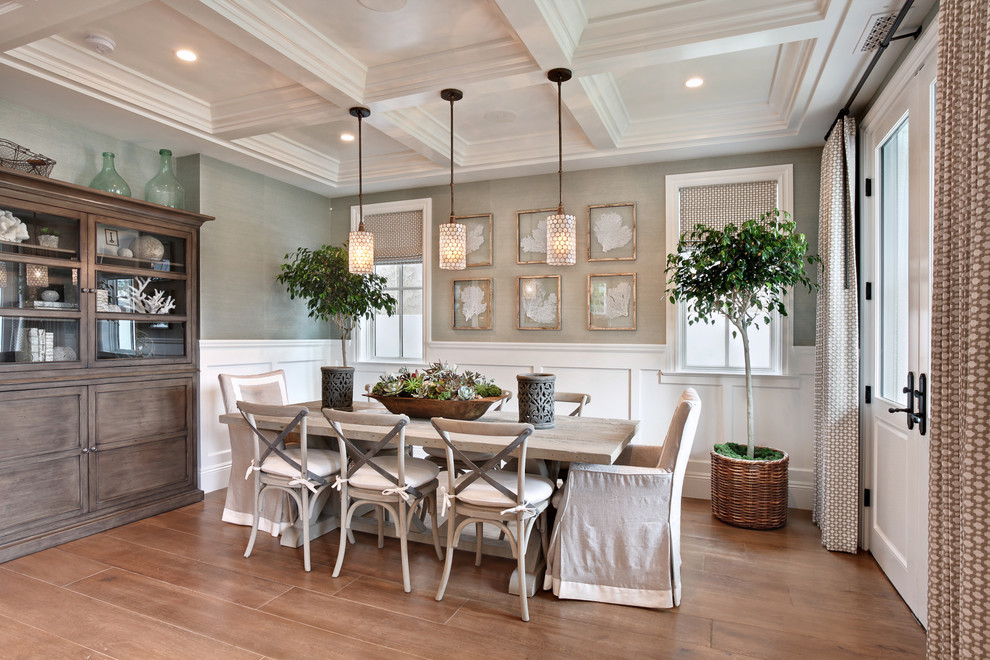 Inspiration for a coastal medium tone wood floor and beige floor dining room remodel in Orange County with gray walls