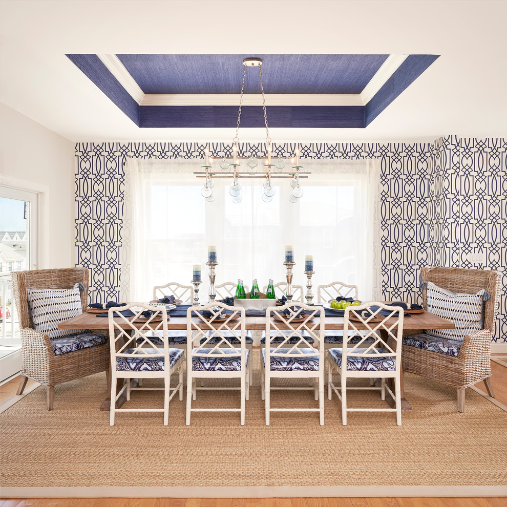 Large beach style medium tone wood floor and brown floor kitchen/dining room combo photo in Philadelphia with blue walls