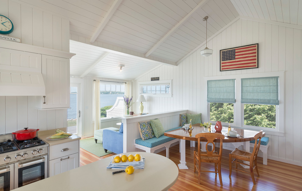 Inspiration for a coastal medium tone wood floor great room remodel in Providence