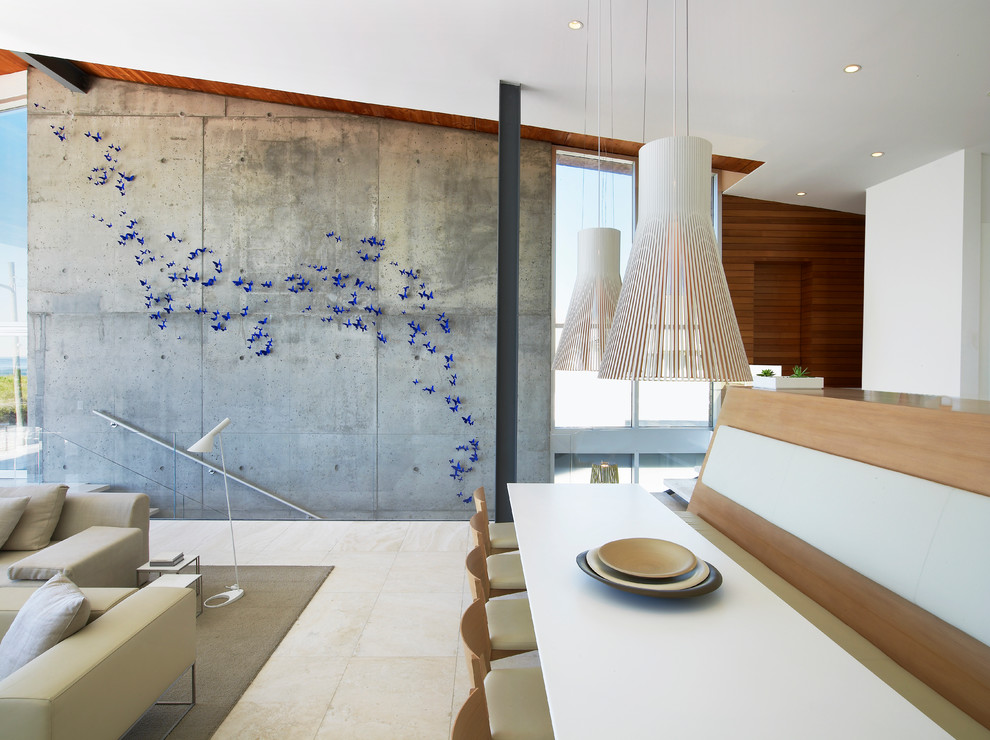 Example of a minimalist great room design in New York with white walls