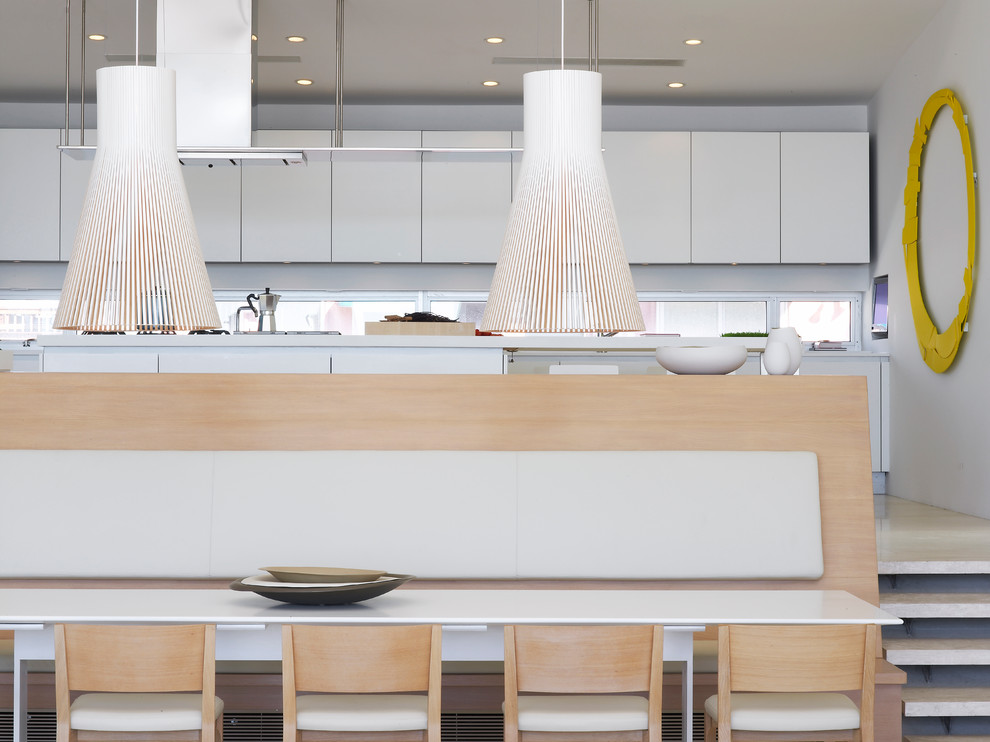 Minimalist kitchen/dining room combo photo in New York with white walls