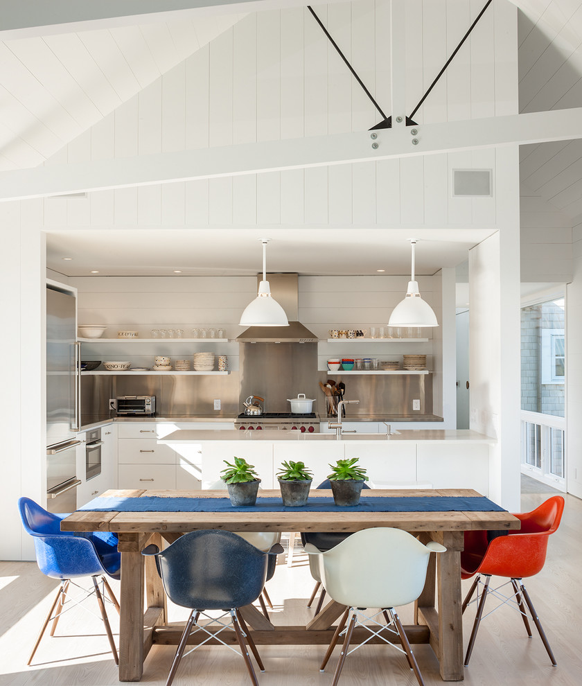Inspiration for a mid-sized coastal light wood floor kitchen/dining room combo remodel in Providence with white walls