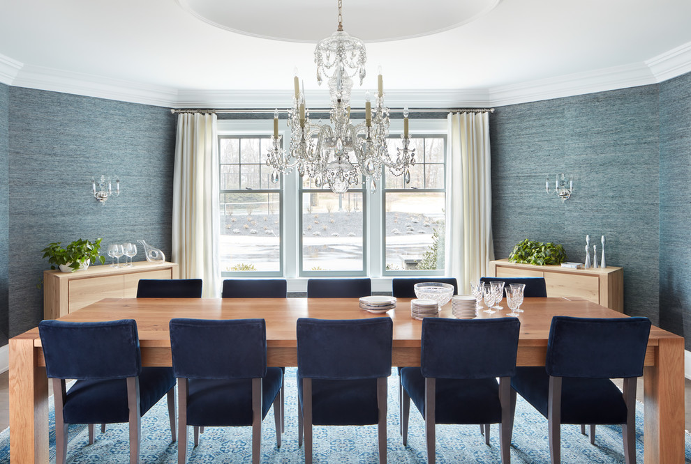 Beach style enclosed dining room photo in Manchester with blue walls and no fireplace