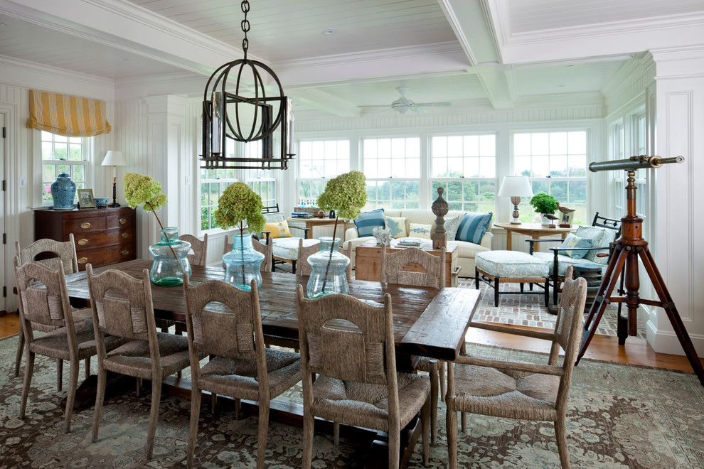 Inspiration for a coastal medium tone wood floor dining room remodel in Boston with white walls