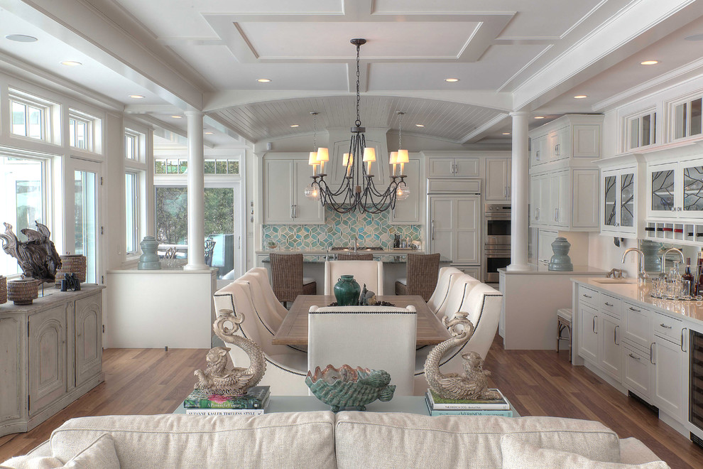 Inspiration for a mid-sized beach style medium tone wood floor great room remodel in Other with white walls