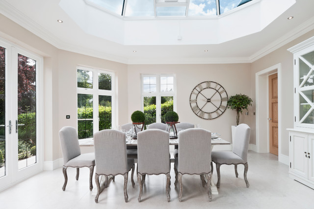 Photo of a modern enclosed dining room in Berkshire with beige walls.