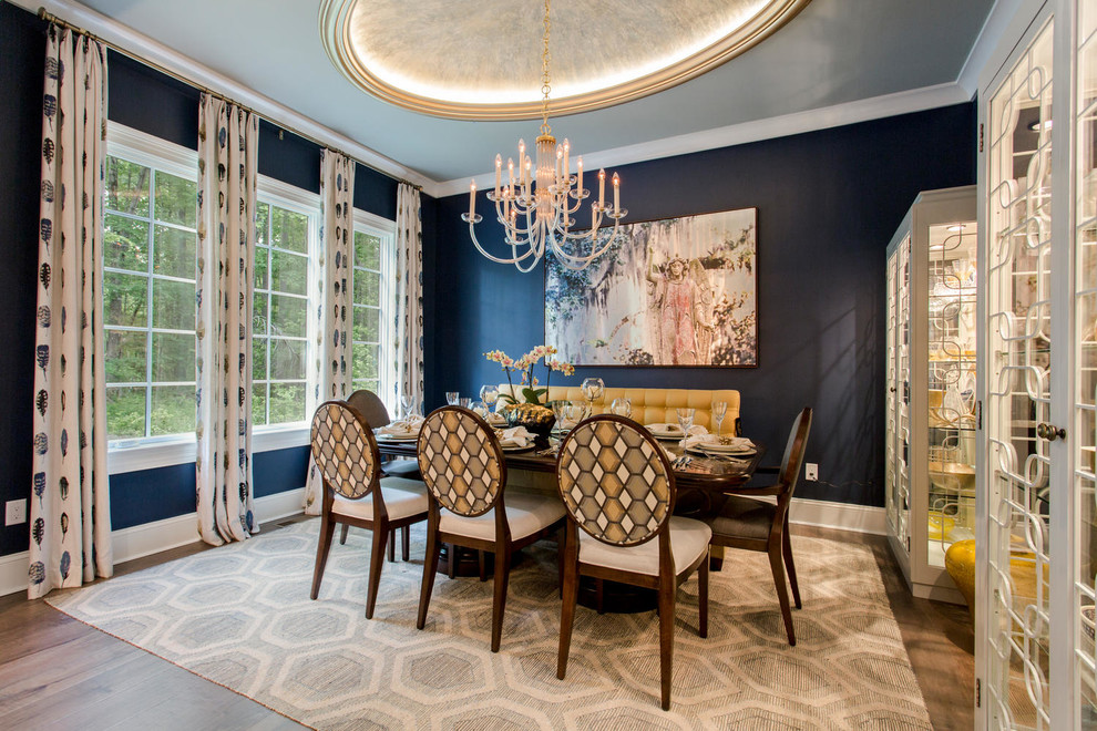 Inspiration for a transitional dark wood floor dining room remodel in Richmond with blue walls