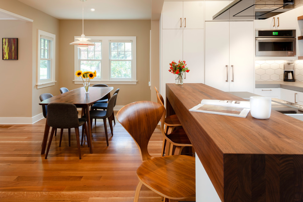 Inspiration for a mid-sized scandinavian medium tone wood floor and brown floor kitchen/dining room combo remodel in Other with beige walls
