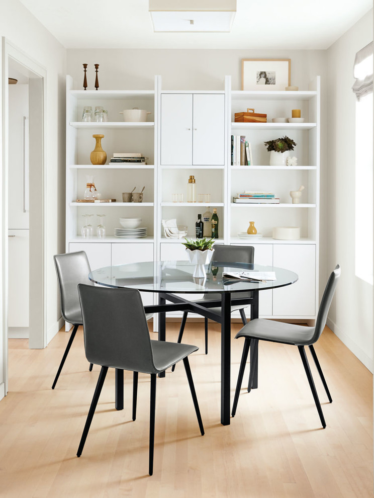 Inspiration for a contemporary light wood floor enclosed dining room remodel in Minneapolis with white walls