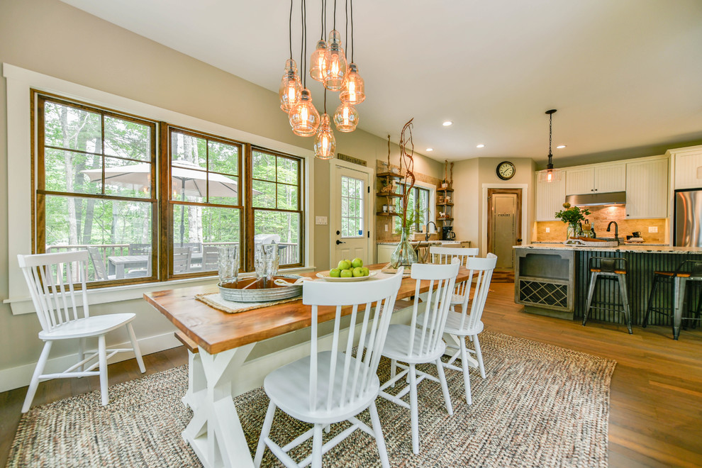 Farmhouse medium tone wood floor kitchen/dining room combo photo in Portland Maine with beige walls