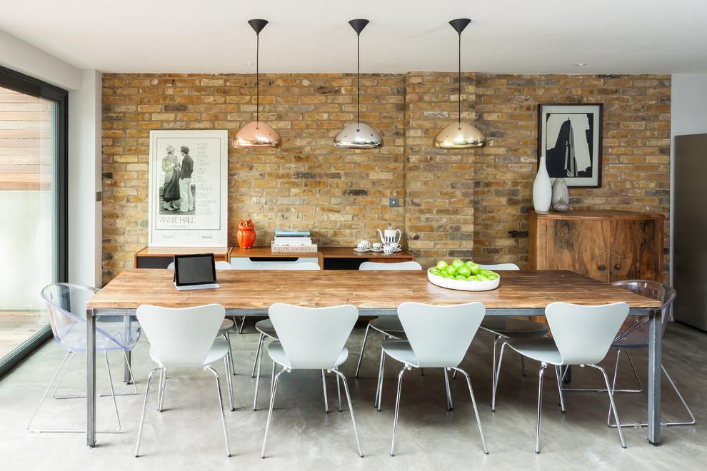 Trendy concrete floor dining room photo in London