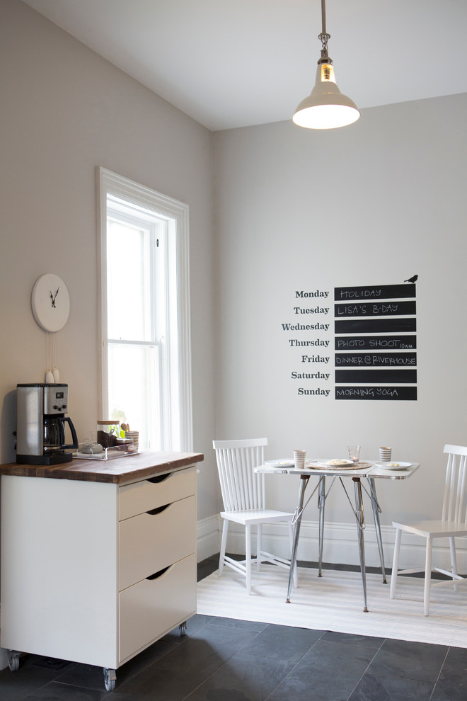 Example of a small trendy slate floor dining room design in Toronto with gray walls