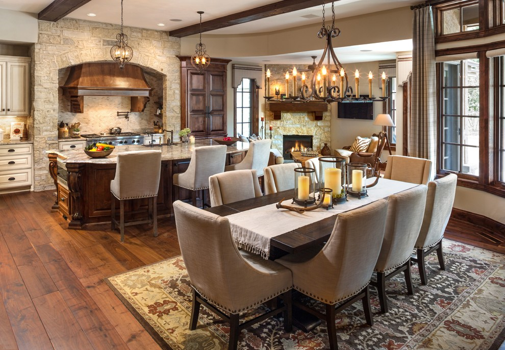 Inspiration for a large timeless dark wood floor kitchen/dining room combo remodel in Milwaukee with a corner fireplace and a stone fireplace