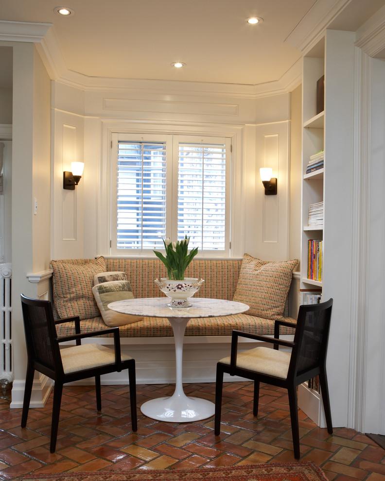 Elegant terra-cotta tile dining room photo in Toronto with beige walls