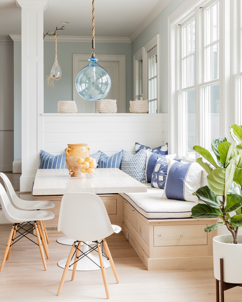 Example of a coastal light wood floor great room design in Boston with blue walls