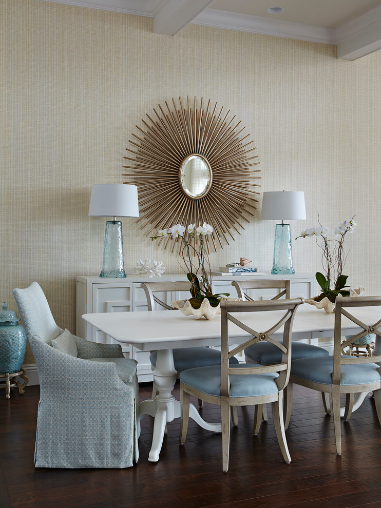Beach style dining room photo in Miami with beige walls
