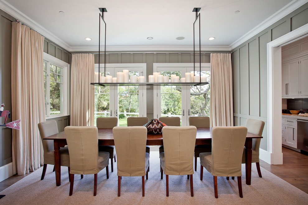 Inspiration for a timeless dark wood floor enclosed dining room remodel in Los Angeles with gray walls