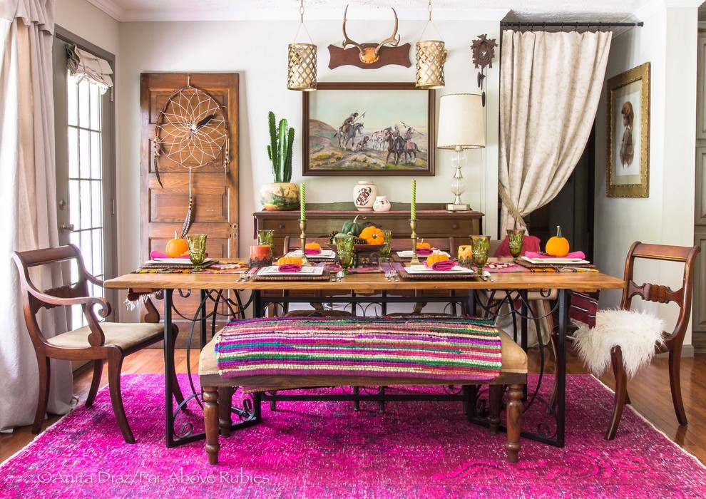 Inspiration for an eclectic medium tone wood floor and brown floor dining room remodel in Other with beige walls