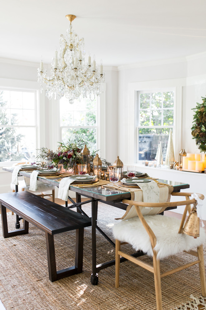 Example of a transitional medium tone wood floor and brown floor dining room design in Sacramento with white walls