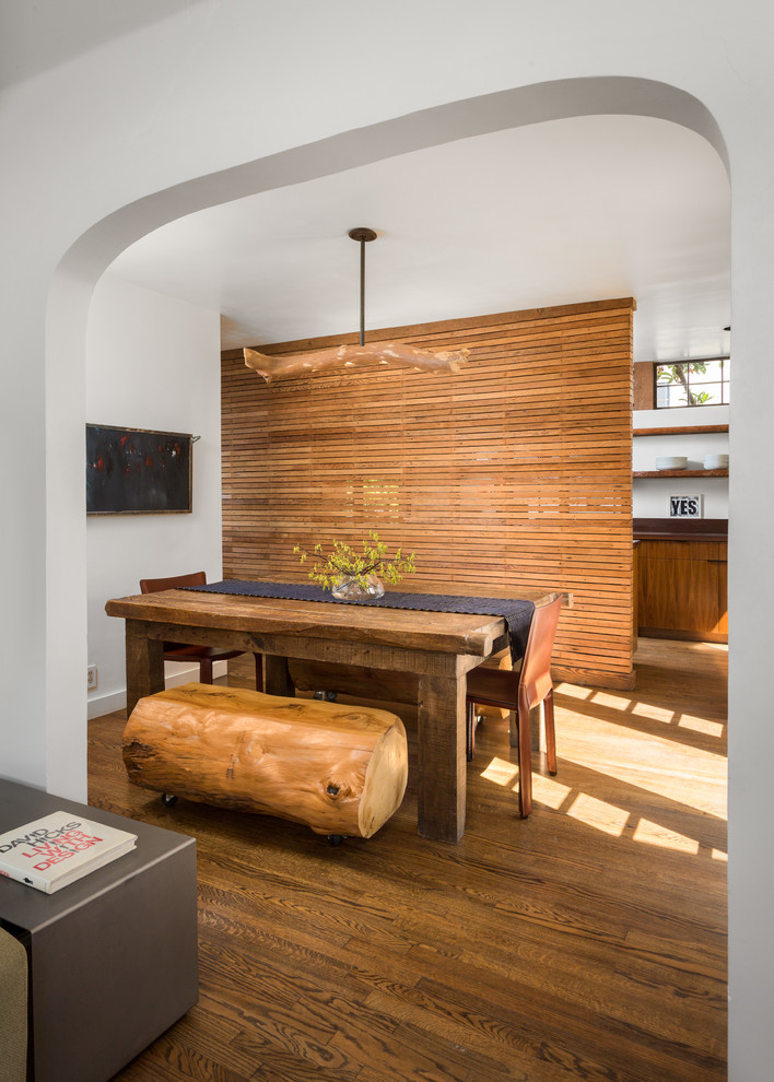 Kitchen/dining room combo - small contemporary medium tone wood floor and brown floor kitchen/dining room combo idea in Los Angeles with white walls and no fireplace