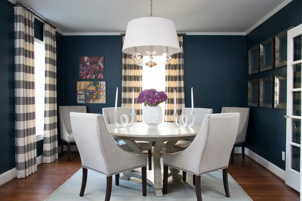 Dining room - traditional medium tone wood floor dining room idea in Houston with blue walls