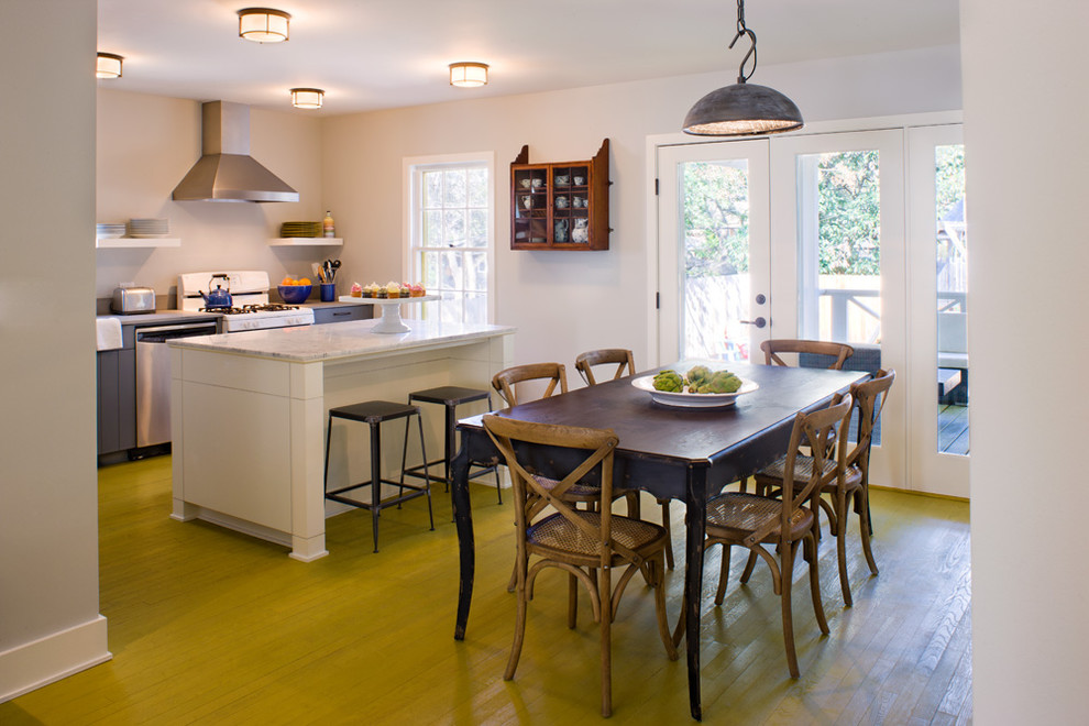 Kitchen/dining room combo - transitional green floor kitchen/dining room combo idea in Austin with white walls
