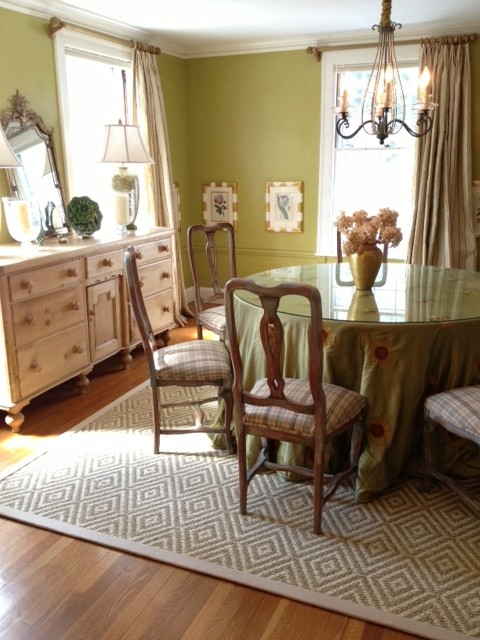 Bordered sisal area rug in dining room transitional for Dining room rugs