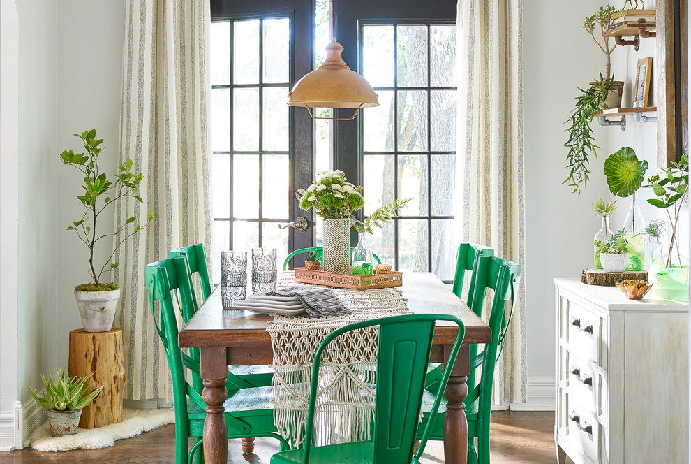 Example of a mid-sized cottage chic brown floor and dark wood floor dining room design in Other with gray walls and no fireplace