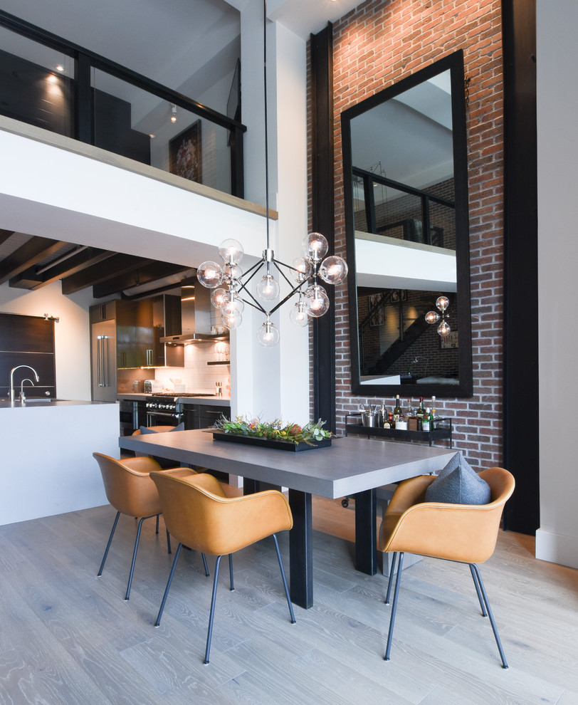 Urban gray floor kitchen/dining room combo photo in Salt Lake City with white walls